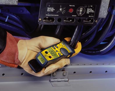Electrician measuring cable with IDEAL TightSight clamp meter while using both back lit displays.